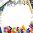 Frame of colorful school supplies on white background — ストック写真