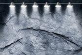 Spotlight illuminating a gray stone wall — Stock Photo