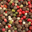 Close up of a background of multicolored peppercorn mix — Stock Photo #36163671