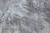 Close up of texture of a gray stone wall — Stock Photo