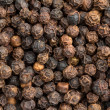 Close up of a background of black pepper — Stock Photo