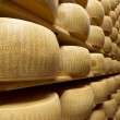 Stock Photo: Parmescheese stacked in maturing warehouse