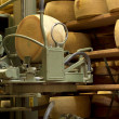 Stock Photo: Robot in maturing storehouse of parmescheese