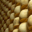Stock Photo: Heap of wheels of cheese in maturing storehouse