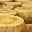 Close up of heap of wheels of seasoned parmesan — Stock Photo #37332505
