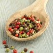 Close up of peppercorn mix in a wooden spoon — Stock Photo