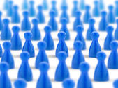 Multitude of blue pawns on white background — Stock Photo