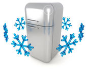 Steel refrigerator and blue snowflakes on white background — Stock Photo