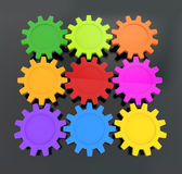 Square of colorful gears on a black background — Stock Photo