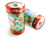 Two batteries full of colorful pills on white background — Stock Photo
