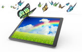 Tablet  and flying butterflies on white background — Stock Photo