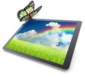 Monarch butterfly resting on a tablet computer — Stock Photo