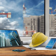 Tablet, smartphone, safety helmet and blueprints in construction site — Stock Photo #51201123