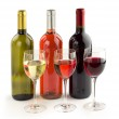 Set of wine bottles and wineglasses on white background — Stock Photo #51201485