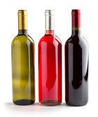 Set of three wine bottles on white background — Stock Photo