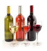 Set of wine bottles and wineglasses on white background — Stock Photo