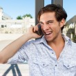 Young male adult on the cellphone laughing. — Stock Photo