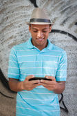 Young adult typing on the cellphone. — Stock Photo