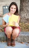Young female holding books — Stock Photo
