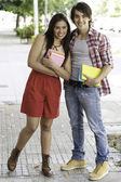 Young couple in the street — Stock Photo