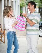 Beautiful woman receiving a gift — Foto de Stock