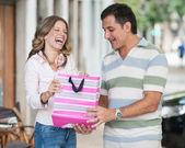Beautiful woman receiving a gift — Stockfoto