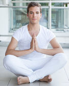 Young adult meditating with hands together — Stock Photo