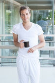 Young adult holding a cup of coffee — Stock Photo