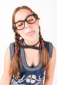 Young nerdy and goofy girl sticking out her tongue. — Stock Photo
