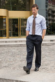 Business man walking out of the office — Stock Photo