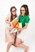 Cute nerdy girls bump into each other. — Stock Photo