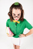 Nerdy girl holding books looking at camera. — Stock Photo