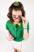 Nerdy girl holding spectacles looking up. — Stock Photo