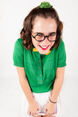 Nerd girl shrugging shoulder portraying shyness . — Stockfoto