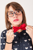 Young nerdy shy girl thinking. — Stock Photo