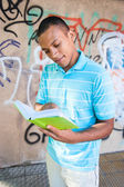 Young sexy male reading a book. — Stock Photo