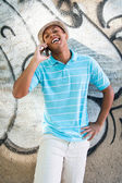 Young sexy male talking on the cellphone. — Stock Photo