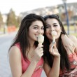 Girls eating ice cream — Stock Photo