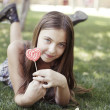 Girl with colouring lollipop — Stock Photo