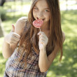 Stock Photo: Happy girl eating lollipop
