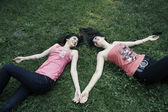 Happy girls on grass — Stock fotografie