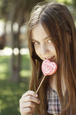 Girl with coloring lollipop — Photo