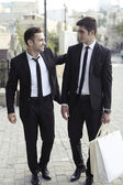 Purchase of businessmen,shopping guys — Stock Photo