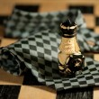 Pawn over necktie on chessboard — Foto Stock