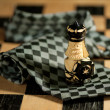 Pawn over necktie on chessboard — Stok fotoğraf