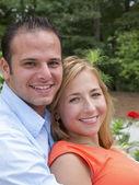 Happy couple looking at camera — Stock Photo