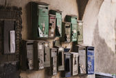 Few old mailboxes hanging on the wall in Romania — Stock Photo