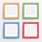 Color frame set on gray wall. — Stock Vector