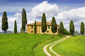 Rural house with cypress trees around, Tuscany, Italy — Stock Photo