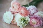 Ranunculus bouquet on craft paper — Stock Photo
